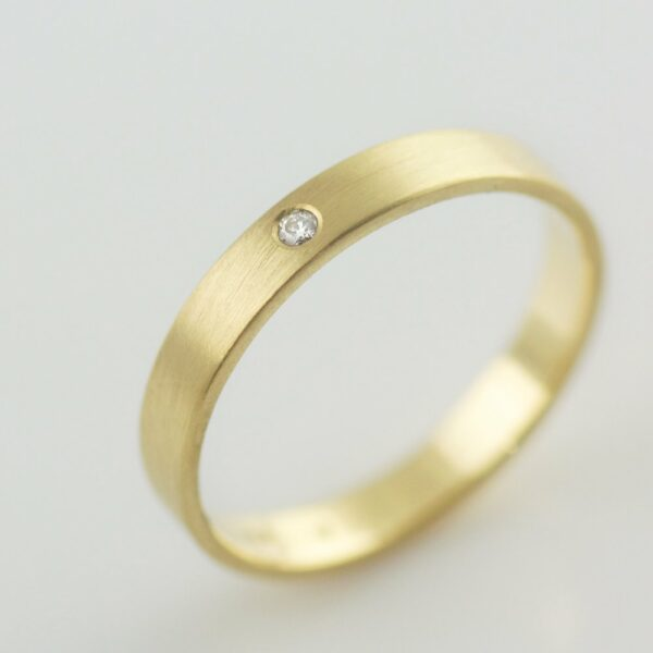 18k recycled gold ring with white diamond made in portland
