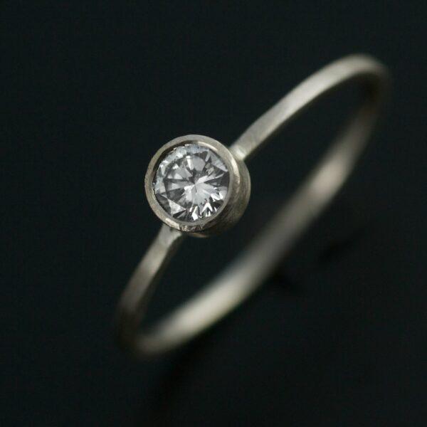 quarter carat diamond in white gold engagement ring handmade