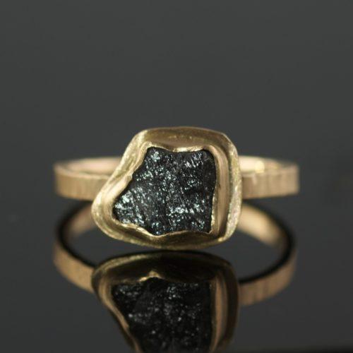 raw diamond black diamond in gold ring