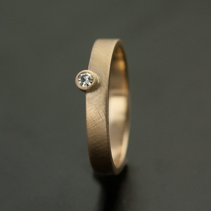 minimal wedding ring offset small diamond custom design