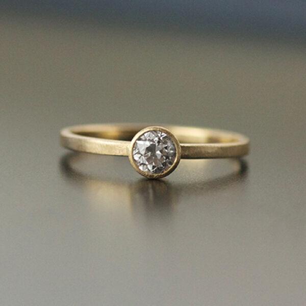 4mm bezel set diamond yellow gold