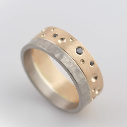 mixed metal ring with yellow gold and white gold black diamonds