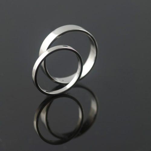 polished platinum flat wedding rings