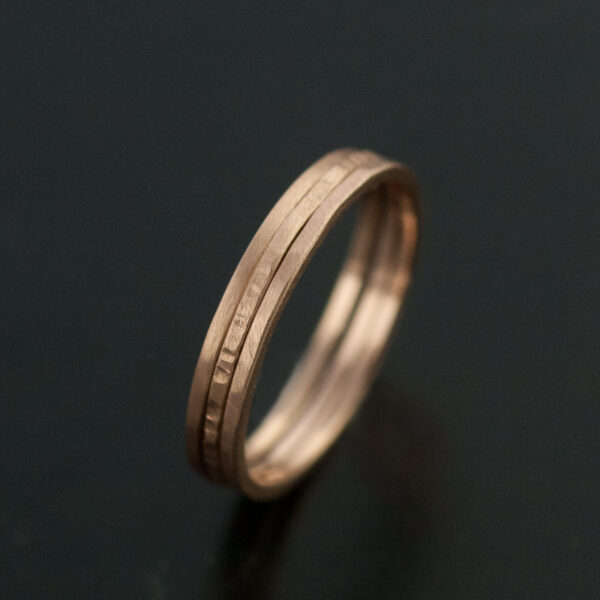 three thin rose gold rings hammered