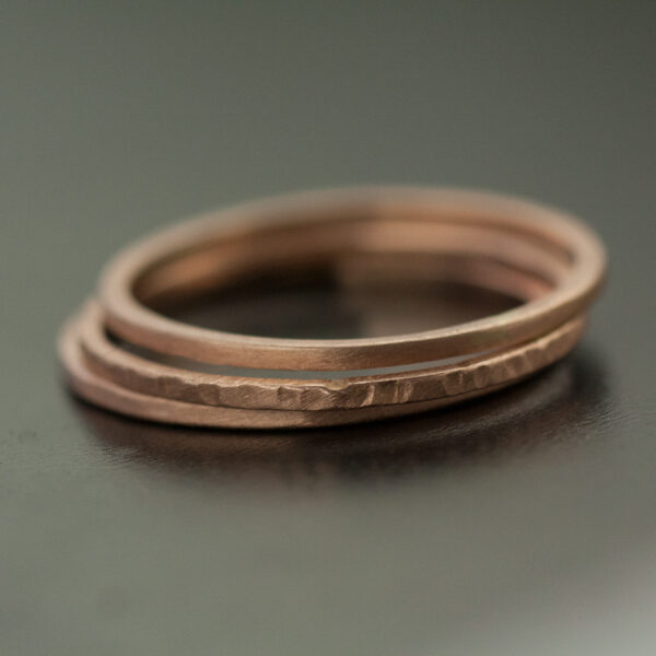 three rose gold rings one hammered