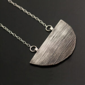 silver necklace with texture