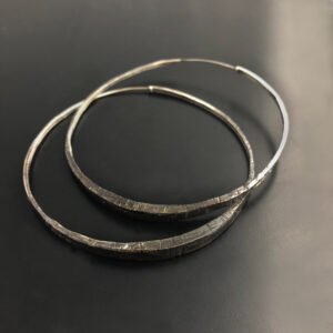 silver hoop earrings black