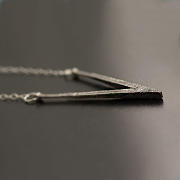 silver necklace with texture black