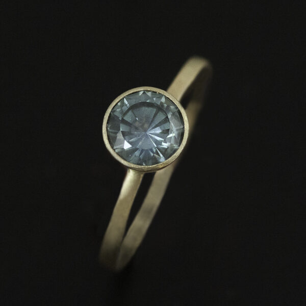blue montana sapphire custom cut unique engagement ring in 14k yellow gold